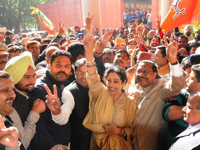 MP Kirron Kher, former MP Satya Pal Jain, senior deputy mayor Devesh Modgil and other BJP workers in a jubilant mood after the mayoral polls on Friday