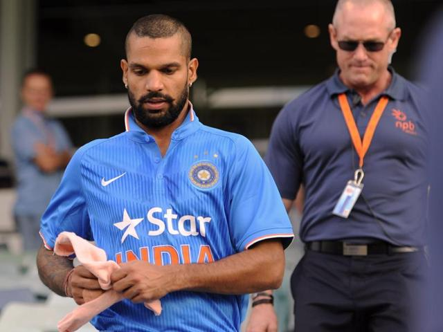 India's Shikhar Dhawan walks onto the field to warm-up against Western Australian XI in Perth.