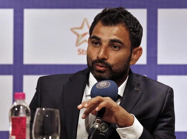 Indian cricketer Mohammed Shami speaks during a news conference in Mumbai.