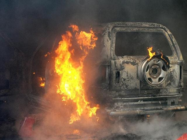 A vehicle up in flames after it caught fire at Ivory Towers in SAS Nagar on Saturday.