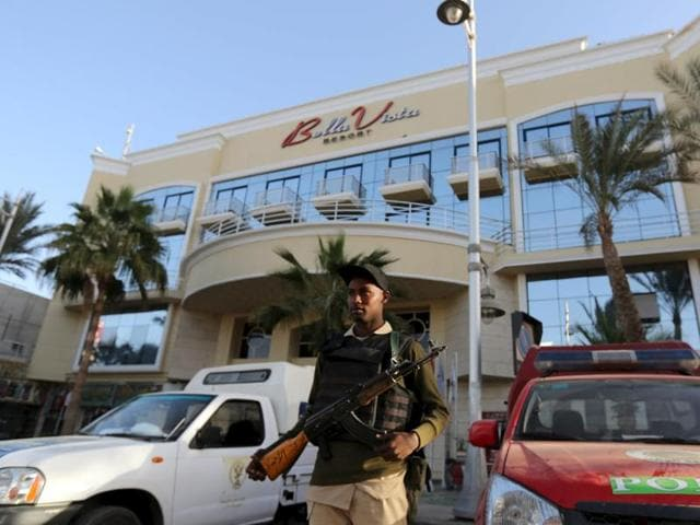 A member of the Egyptian security stands guard in front of the entrance to Bella Vista Hotel in the Red Sea resort of Hurghada, Egypt on Saturday. Three foreign tourists were wounded in knife attacks by two assailants in the hotel  on Friday.