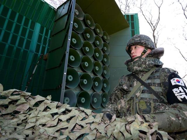 A South Korean soldier operates loudspeakers, just south of the demilitarized zone separating the two Koreas, in Yeoncheon.  South Korea on Friday unleashed a ear-splitting propaganda barrage over its border with the North.