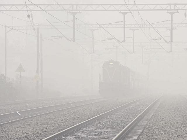 Many trains ran late due to heavy fog at Tilak Bridge railway station in New Delhi on Friday.