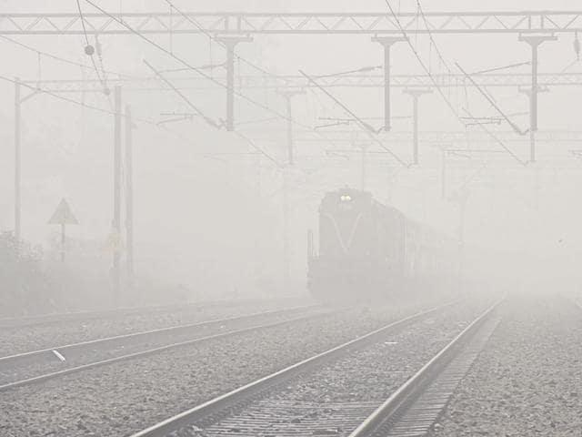 Many trains ran late due to heavy fog at Tilak Bridge railway station in New Delhi on Friday.