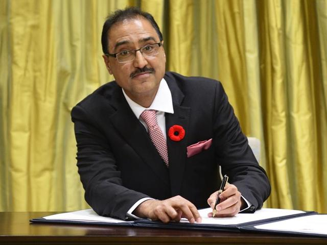 Amarjeet Sohi, as he was sworn in as a Cabinet Minister with Canadian Prime Minister Justin Trudeau looking on.