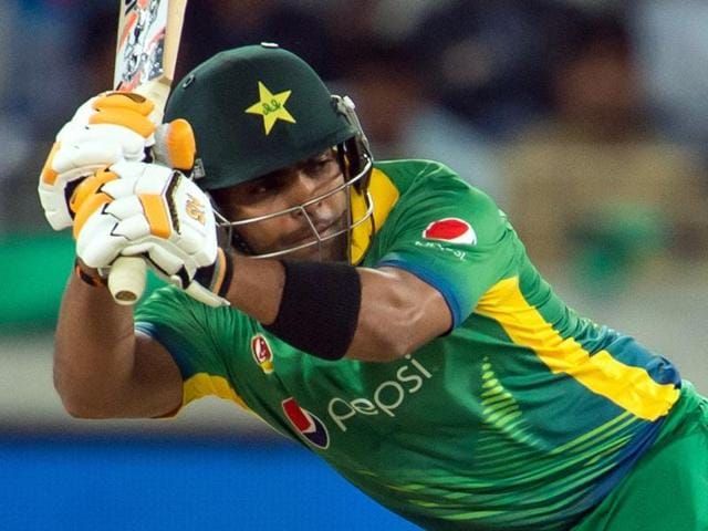 Pakistan's Umar Akmal bats during the first T20 cricket match between Pakistan and England at the Dubai International Cricket Stadium.