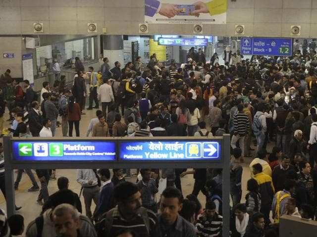 People throng Rajiv Chowk Metro Station in large numbers on the fifth day of the odd-even vehicular restriction trial in New Delhi.