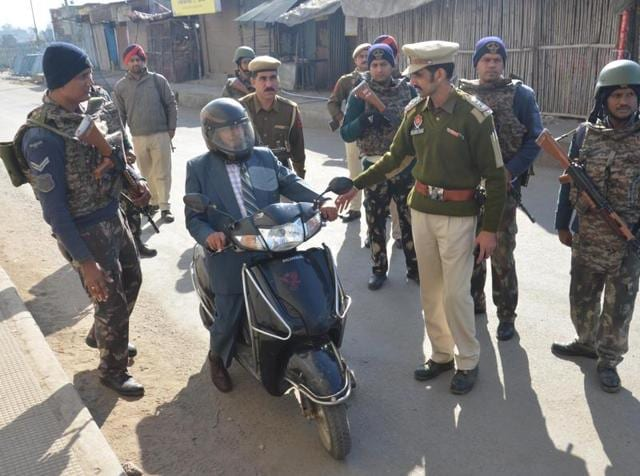Indian Army Personnel check people beofre entering Pathankot Air Force Base.