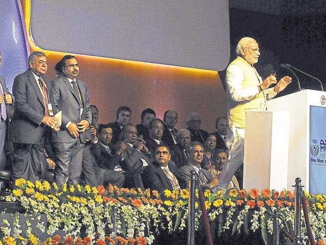 Industrialists watch as Prime Minister Narendra Modi addresses an investors' forum.