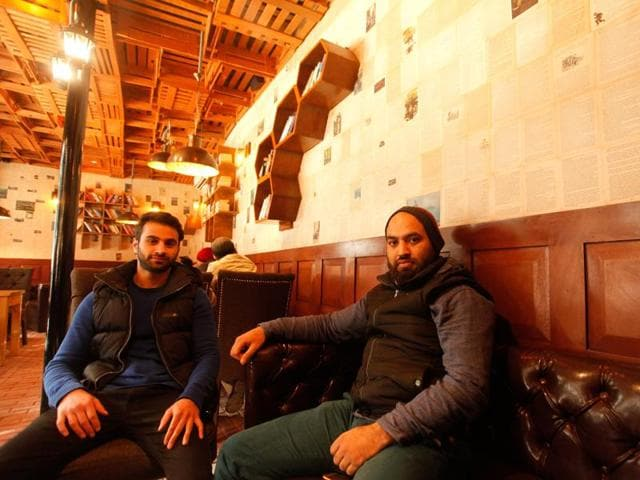 Danish Yousuf and Arsalan Sajad, alumni of a UK university, opened the Books and Bricks Cafe after returning to the Valley.(Waseem Andrabi / HT Photo)