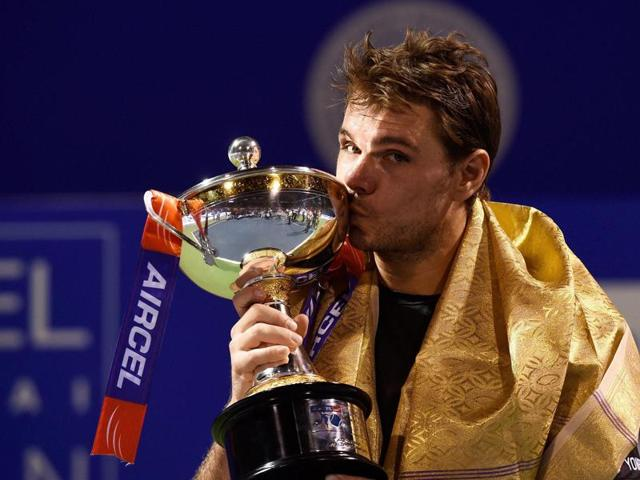 Stan Wawrinka of Switzerland poses with the ATP Chennai Open 2016 trophy after defeating Borna Coric of Croatia in straight sets.