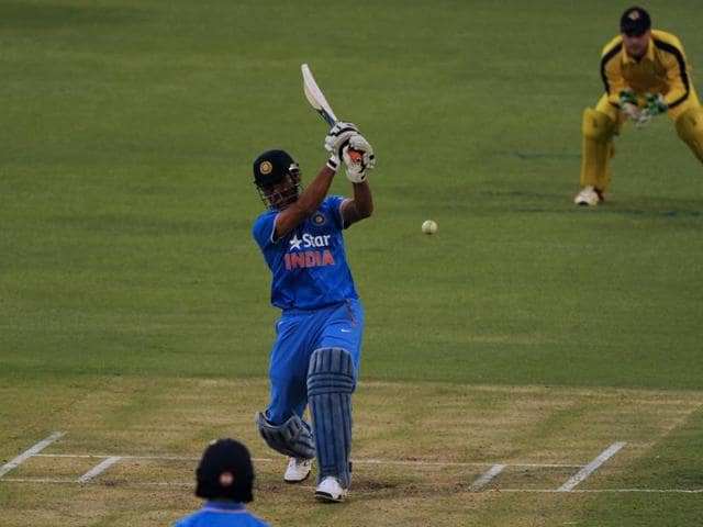 India's Mahendra Singh Dhoni plays a shot during the T20 cricket match between India and a Western Australian XI in Perth.
