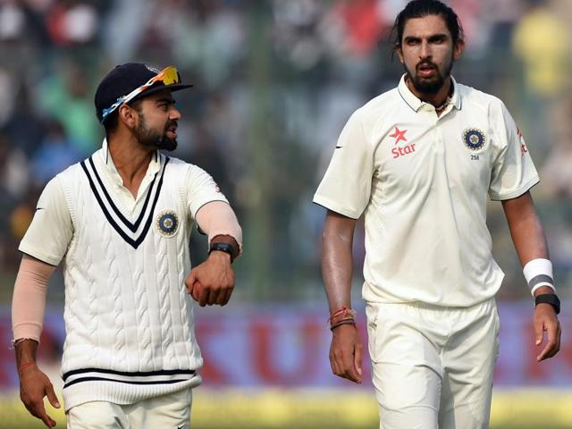 India's captain Virat Kohli talks with Ishant Sharma during the fourth day of the fourth Test cricket match between India and South Africa.