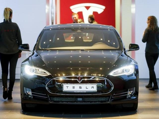 A Tesla Model S sits in a dealership in Berlin in November. The car's Autopilot feature will soon receive an update after which it will now be restricted on residential roads or roads without a center divider.