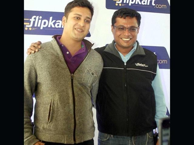India's biggest e-commerce company Flipkart said on Monday its chief executive and co-founder Sachin Bansal (R) will step down and be succeeded by its other co-founder, Binny Bansal.