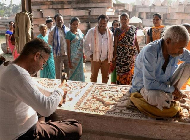 Artists carving stones at a workshop at Karsevakpuram in Ayodhya on Thursday.