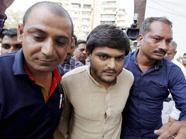 Convener of Patidar Anamat Andolan Samiti Hardik Patel being taken to a court in Surat.