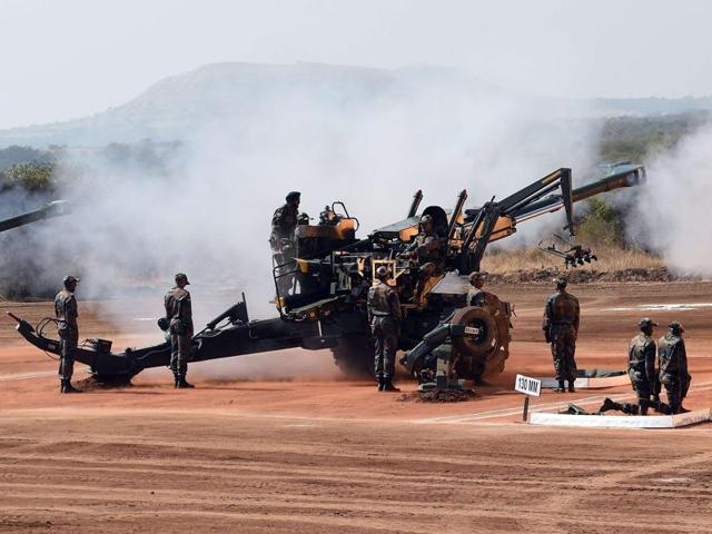 Indian Army soldiers fire a 155mm FH 77B Bofors gun during Exercise Sarvatra Prahar at the School of Artillery in Devlali.