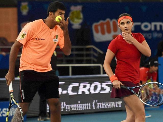 Sania Mirza and Rohan Bopanna play against Phillippine Mavericks players Tom ljanovic and Huey in the Mixed doubles match of IPTL at IG stadium.