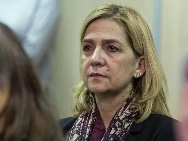 Spain's Princess Cristina sits in court where she appears on charges of tax fraud, as a long-running investigation into the business affairs of her husband goes to trial, in Palma de Mallorca, Spain.