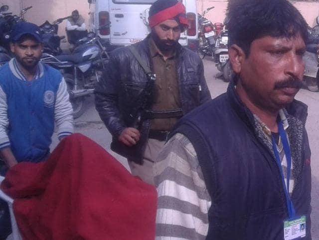 Deranged man who was injured in cross firing between militants and security forces being taken for NIA quizzing in Pathankot civil hospital on Monday.