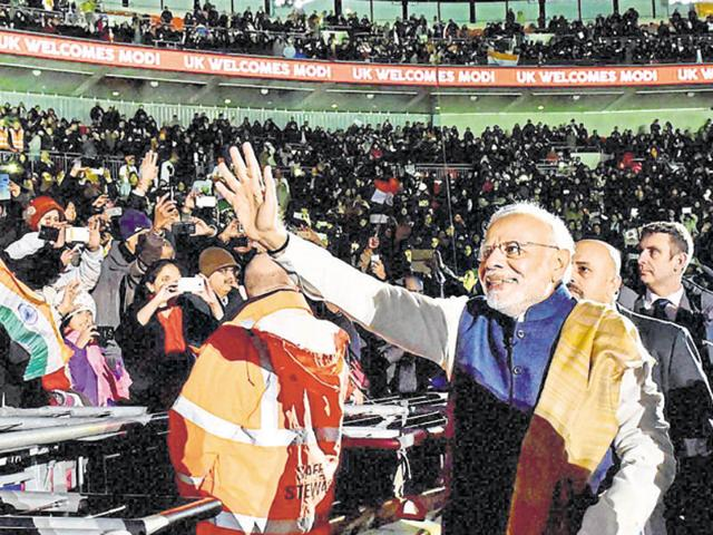 Prime Minister Narendra Modi waves as he leaves after addressing the Indian community at Wembley stadium in London in November