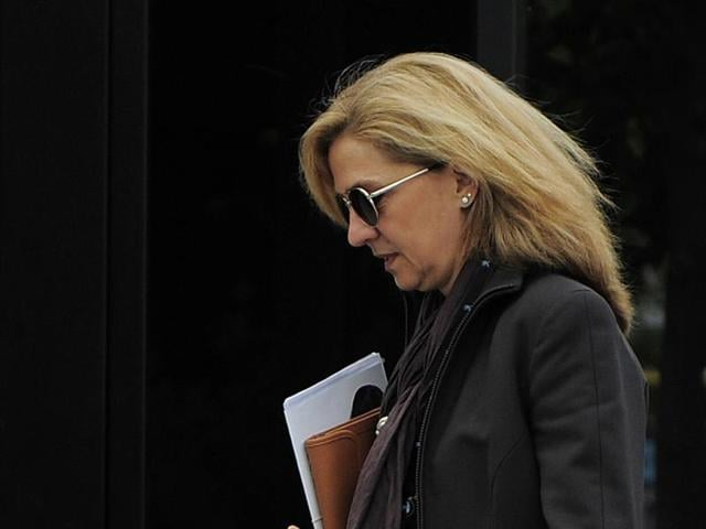 In this April 5, 2013 file photo, Spain's princess Cristina is photographed as she walks toward her office in Barcelona, Spain.