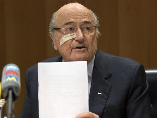 Suspended FIFA President Sepp Blatter gestures during a news conference in Zurich.