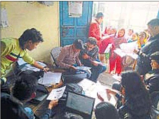 Delhi Technological University students help parents complete the online applications.