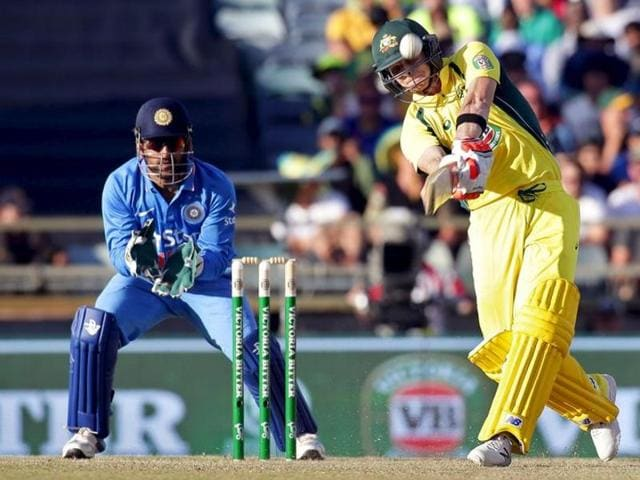 Australia's captain Steve Smith raises his bat after reaching his century against India in Perth.