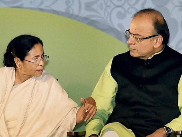 Finance minister Arun Jaitley with West Bengal CMMamata Banerjee during Bengal Global Business Summit in Kolkata on Friday. Souces said the two discussed over the GST bill during this meeting.