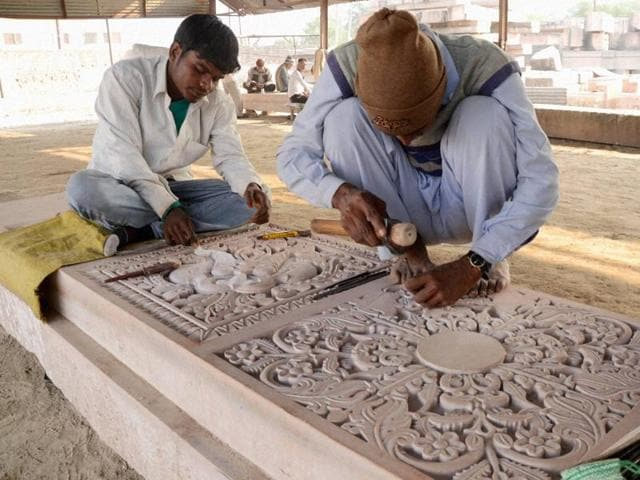 File photo of artists carving stones at a workshop at Karsevakpuram in Ayodhya. The Vishva Hindu Parishad is planning to showcase models of the proposed Ram temple at Ayodhya and many other things on Ram Navami this year.