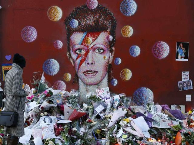 A woman looks at a mural of David Bowie in Brixton, south London, Britain January 12, 2016.