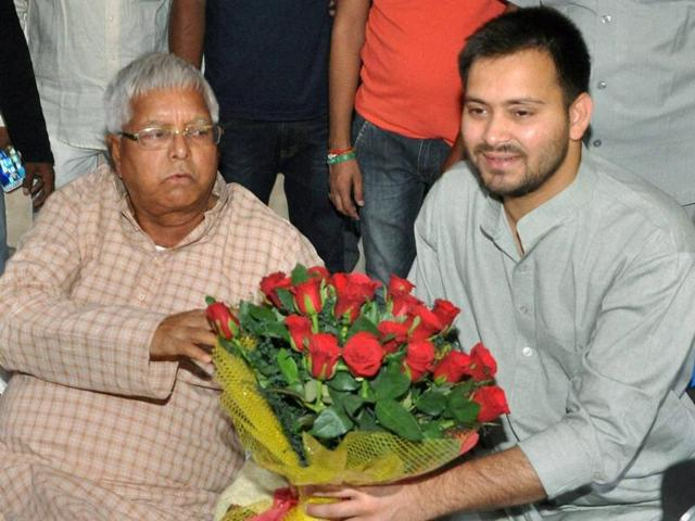 Deputy Chief Minister of Bihar Tejaswi Yadav being greeted by IAS Deepak Prasad after he took charge as Bihar's PWD Minister in Patna.