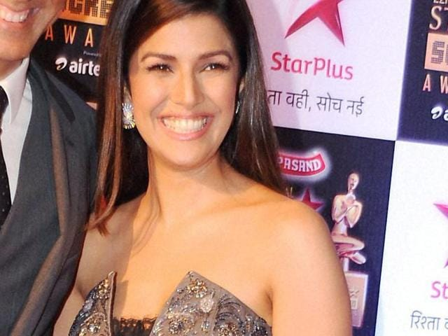 Nimrat Kaur takes a selfie at an event.