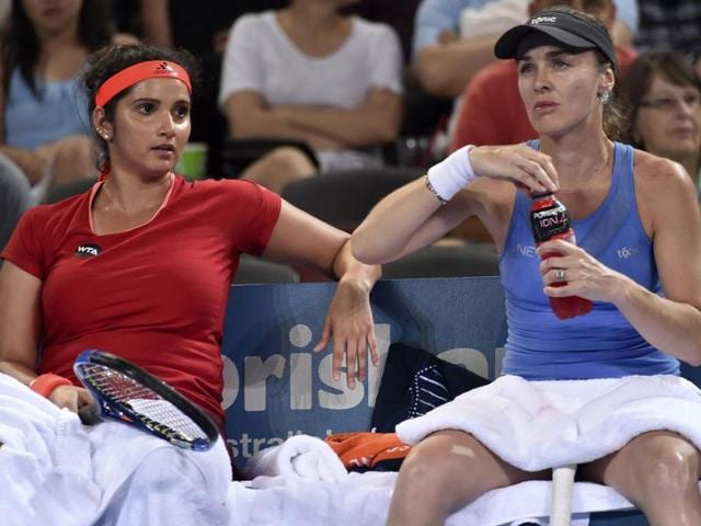 Sania Mirza  and Martina Hingis in action at the Sydney International tournament.