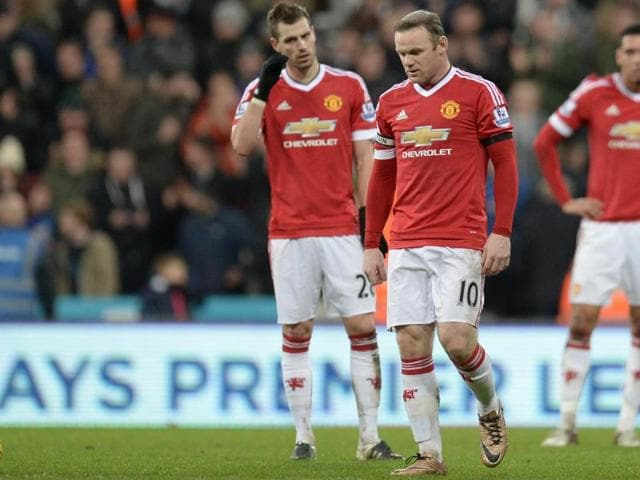 Manchester United's Anthony Martial and Wayne Rooney look dejected after Paul Dummett scored the third goal for Newcastle during their EPLgame at St. James' Park on January 12, 2016.