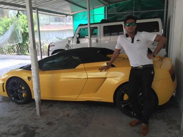 If Ambia Sohrab is not driving a Porche or a Hummer around, one would probably find him posing with a Bugatti for a photograph.
