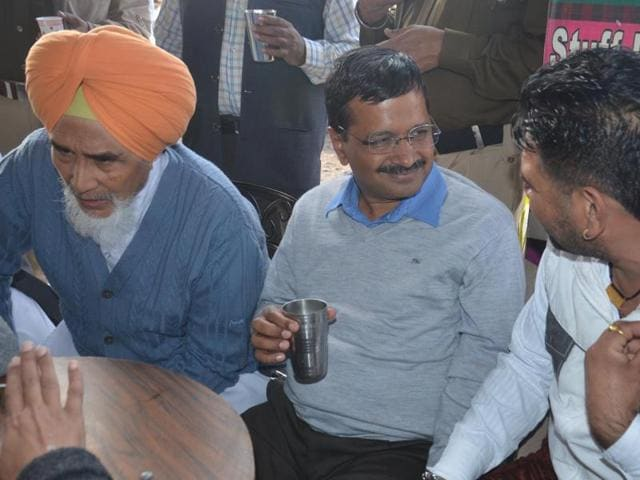 Delhi CM Arvind Kejriwal on a short tea break at a roadside dhaba near Jayantipur on the outskirts of Amritsar on Wednesday.