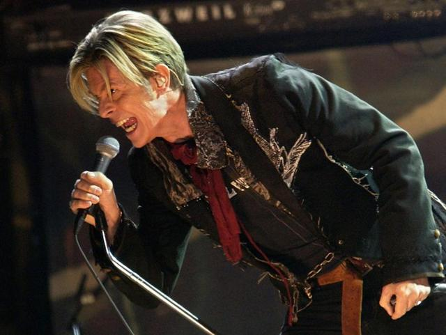 In this file photo, British rock legend David Bowie performs on stage,at the Bercy stadium in Paris. The final album by David Bowie, released just two days before his death, has soared in sales and looked set to top charts around the world.