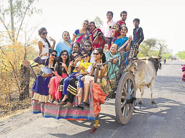 A family enjoys a bullock cart ride to Bibrod village in Ratlam district on January 9.