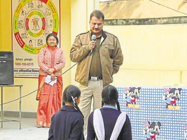 Students attend a class by DCP (traffic) Haidar Ali on National Youth Day, at a government girls school, in Jaipur on Tuesday.