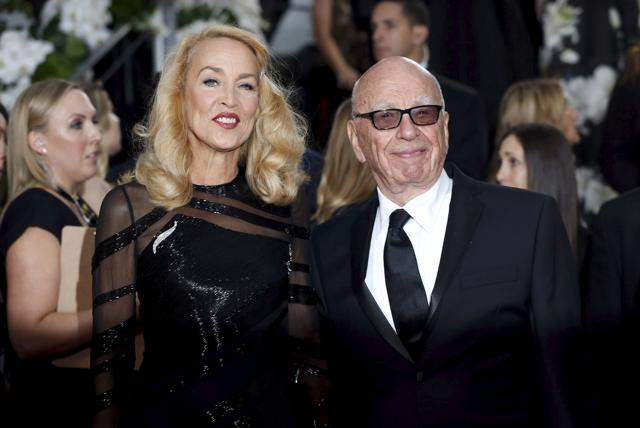 Model Jerry Hall and media magnate Rupert Murdoch arrive at the 73rd Golden Globe Awards in Beverly Hills.