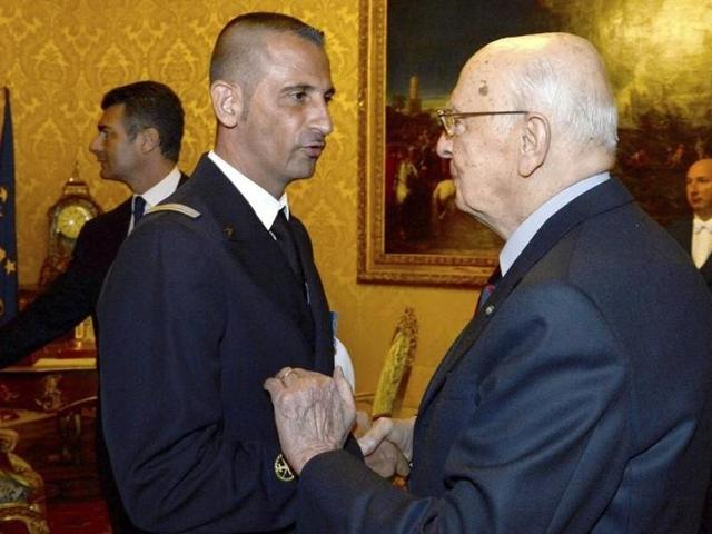 Italian President Giorgio Napolitano (R) shakes hands with Italian marine Massimiliano Latorre during a meeting at Quirinale presidential palace in Rome.