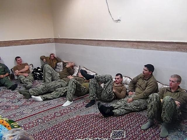 A picture released by the Iranian Revolutionary Guards on Wednesday, Jan. 13, 2016, showing detained American Navy sailors in an undisclosed location in Iran. Iranian state television is reporting that all 10 U.S. sailors detained by Iran after entering its territorial waters have been released.