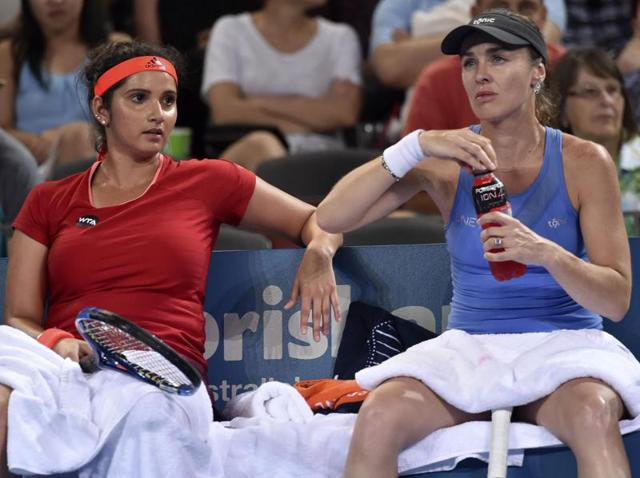Sania Mirza of India (L) and Switzerland's Martina Hingis are on a 28-match winning streak, and are now two wins away from their 10th title together, and second straight of this year.