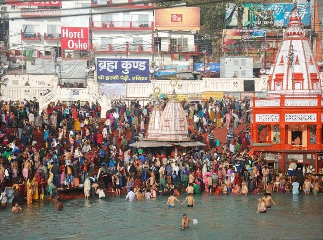 Devotees take a holy dip in the Ganga on the first day of Ardh Kumbh Mela in Haridwar, on Thursday.