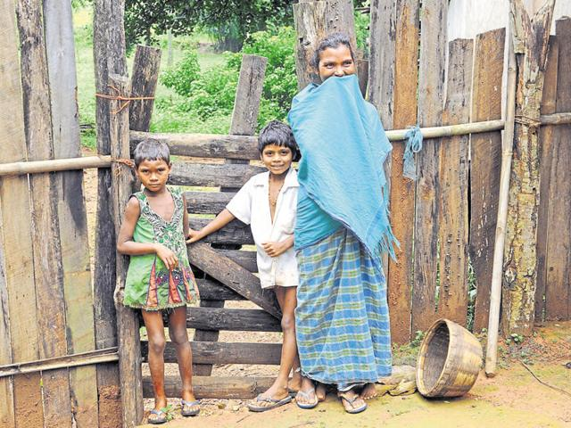 A Paharia tribal woman and her children at Sunder Pahari in Godda district.