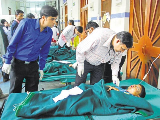 Doctors examine a victim of road accident at Doon district hospital.