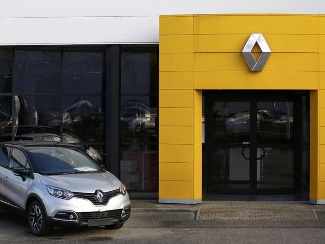 The logo of French car manufacturer Renault is seen at the entrance of a dealership in Vendenheim near Strasbourg, January 14, 2016. Shares in French carmaker Renault tumbled more than 20% on Thursday after a union official said the firm's offices were searched last week regarding a fraud investigation possibly linked to emissions.